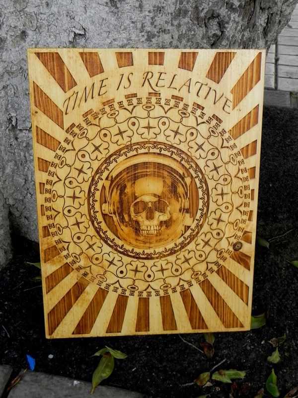 """Time is Relative "" by Diego Scaglia Rat, laser engraved on pine wood, 11,8"" x 15,7 """